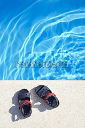 sandals at the swimming pool