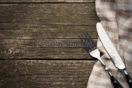 fork and knife on old wooden