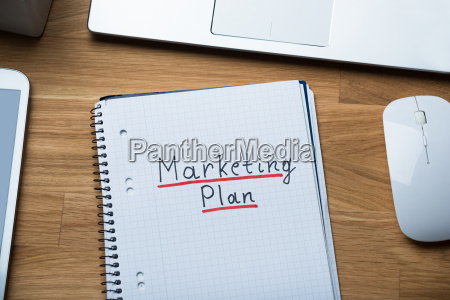 marketing plan written on notepad at