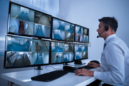 security system operator looking at cctv