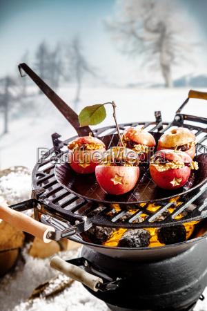 tasty stuffed apples roasting on a