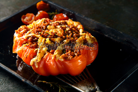 piquant stuffed roasted ripe red tomato