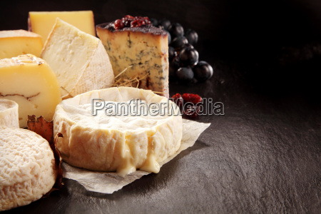 variety of gourmet cheeses on textured