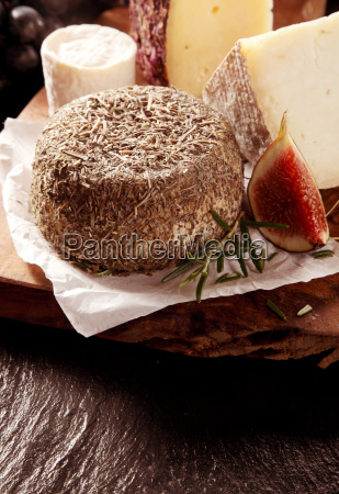 soft cheese coated in herbs served