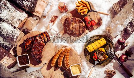 seasonal winter barbecue in snow