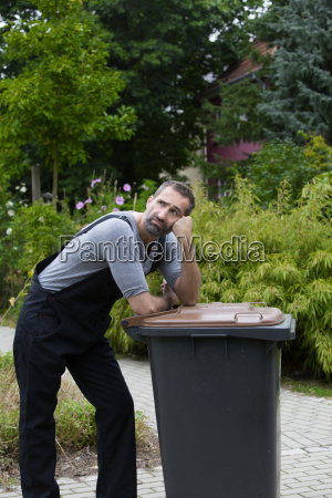 man with trashcan