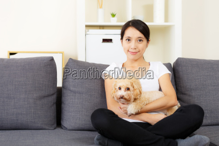 asia woman and poodle dog at