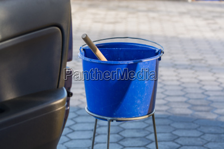 blue bucket with water at a