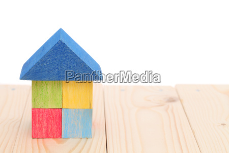 wooden toy house with colored toy