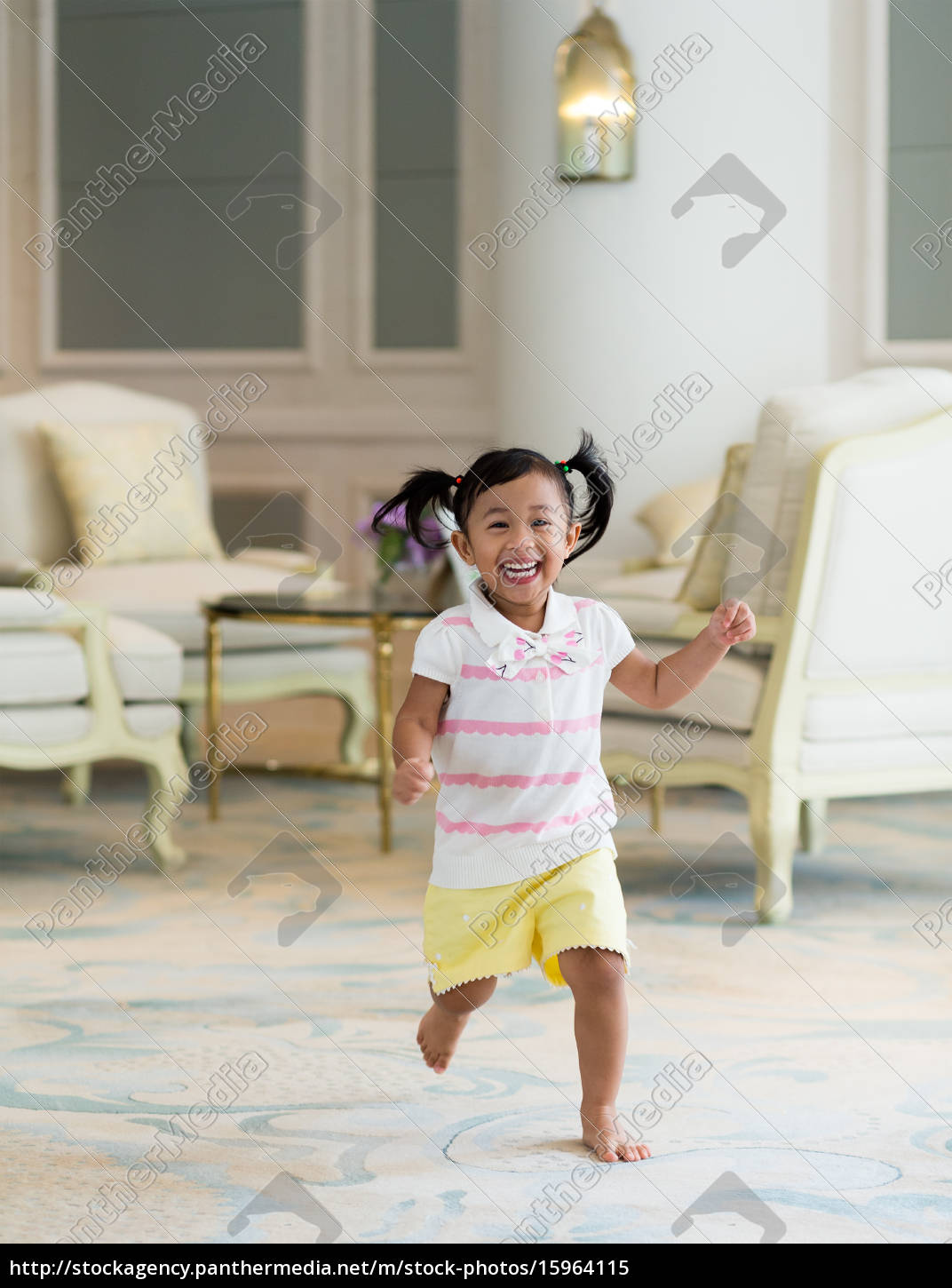 thrilled, girl, running, at, home - 15964115