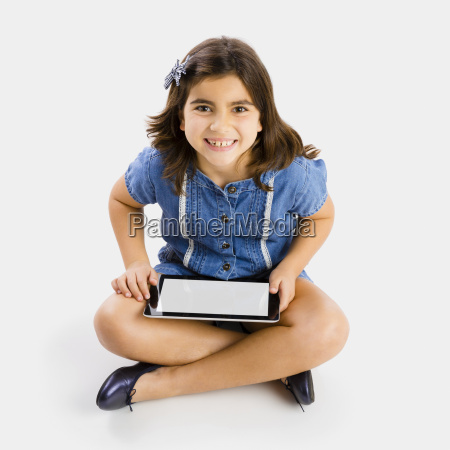 young girl using a tablet