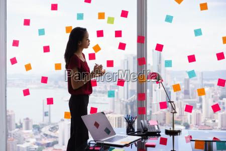 secretary organizing tasks writing sticky notes