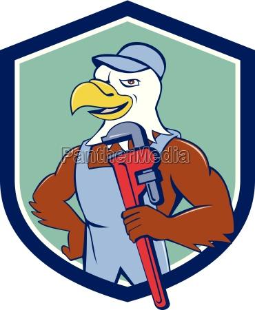 bald eagle plumber monkey wrench crest