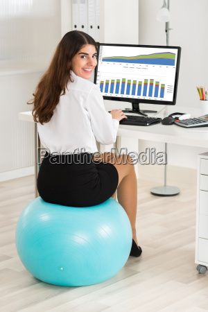 businesswoman using computer while sitting on
