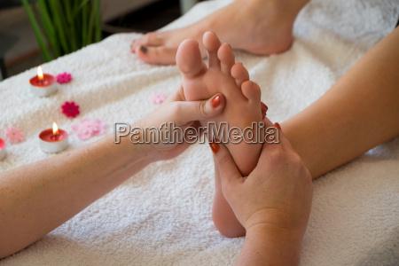 female foot being massaged