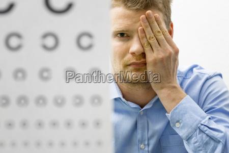 eyesight check male patient under eye