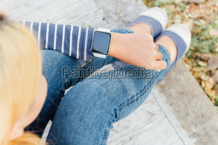 hipster woman looking smart watch new
