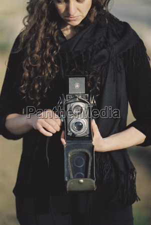 a woman taking a picture with