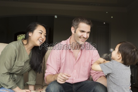 smiling man and woman sitting side