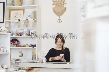 a mature woman sitting using a