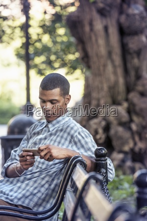 a man seated on a park