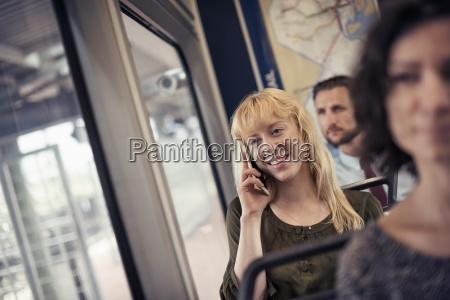 a blond woman on a city