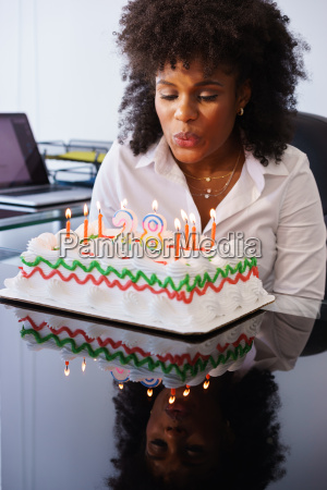 business woman celebrating birthday party in