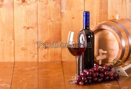 glass of red wine bottle barrel