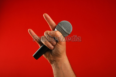 man hand with microphone and devil