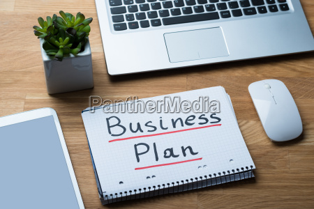 business plan written on notepad at