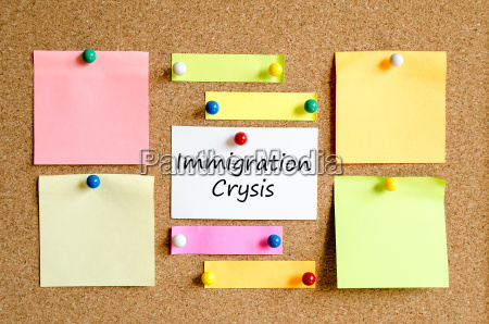 immigration crysis sticky note text concept