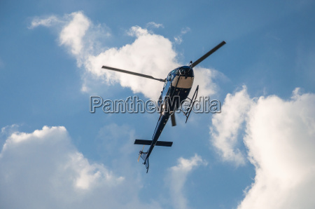 blue helicopter in the air