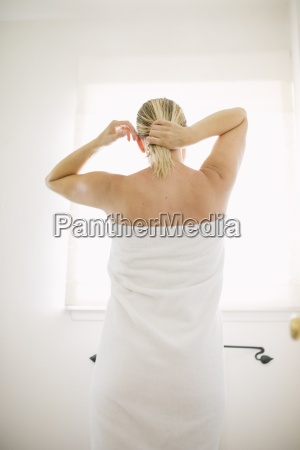 woman wrapped in a white towel