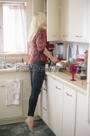 blonde woman standing in a kitchen