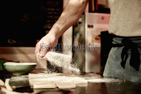 a baker working on a floured