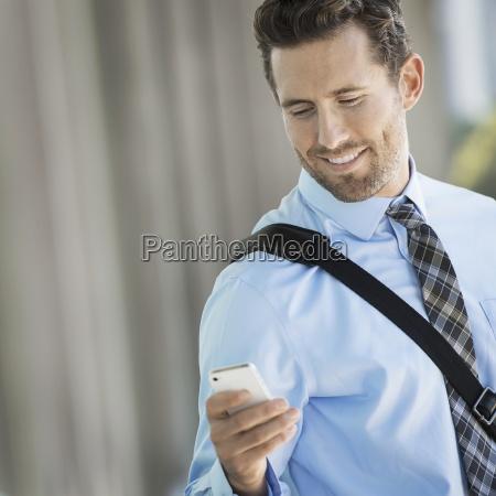 a man with a shoulder bag