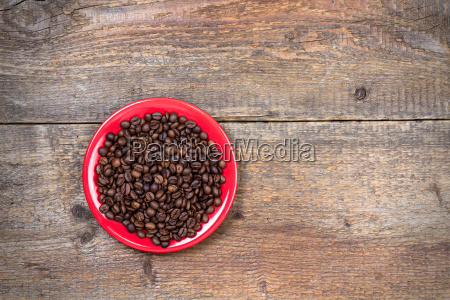 coffeebeans on plate and dark wooden