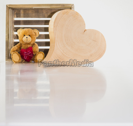 a teddy bear and a wooden