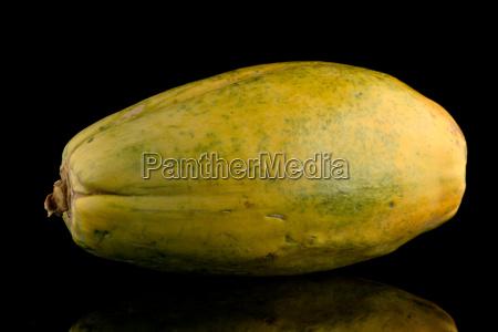 papaya fruit on black background