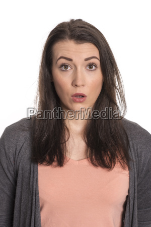 young woman in portrait looks astonished