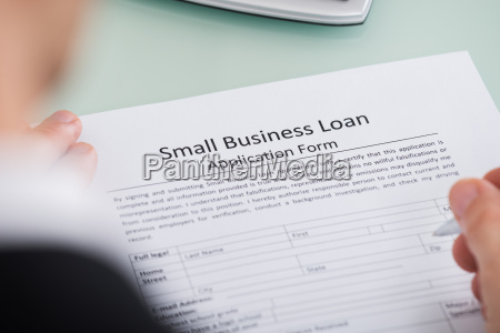 person hand over small business loan
