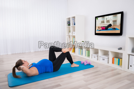 pregnant female doing workout by lying