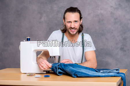 young tailor with sewing machine