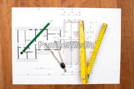 building plan with pencil folding yardstick