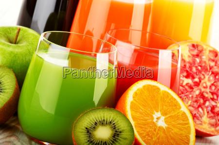 glasses of assorted fruit juice detox
