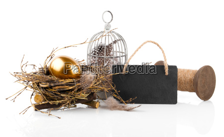 easter decoration with golden egg in