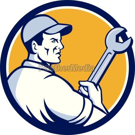 mechanic holding monkey wrench circle retro