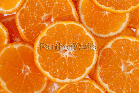 background of slices of clementine fruit