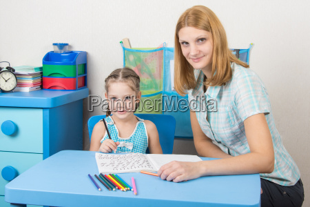 young girl sitting at a table