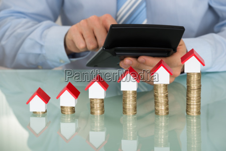 businessman with calculator in front of